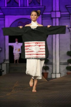 "A model showing Mendrilla's ""The Little Conch"" line of clothing in a Zagreb (Croatia) fashion show, which she has dedicated to acclaimed Hindu statesman Rajan Zed"